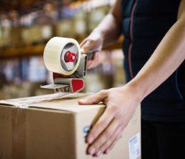 male-warehouse-worker-sealing-cardboard-boxes-PSKUTTE.jpg